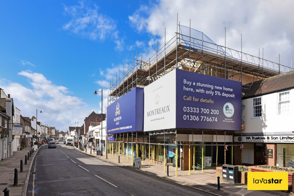 Wide format printed building banner in Dorking