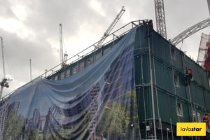 Lifting up a printed banner on a cabin wrap in London