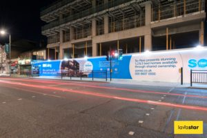 illuminated dibond hoarding at night in London