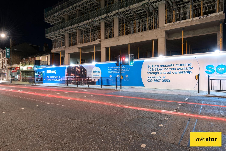 illuminated dibond hoarding at night in London
